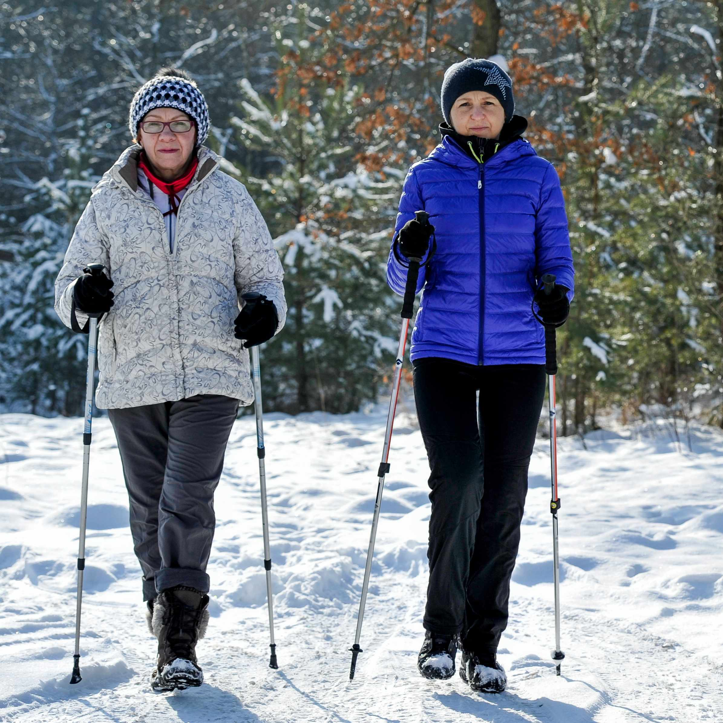 woman cross country skiing and exercising in the snow