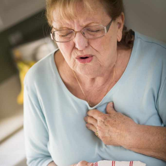 woman with chest pain, stress, heart attack