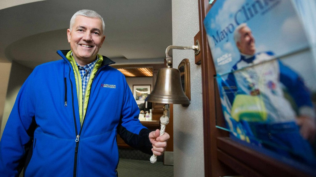Tommy Archer ringing the bell to mark the end of radiation treatments