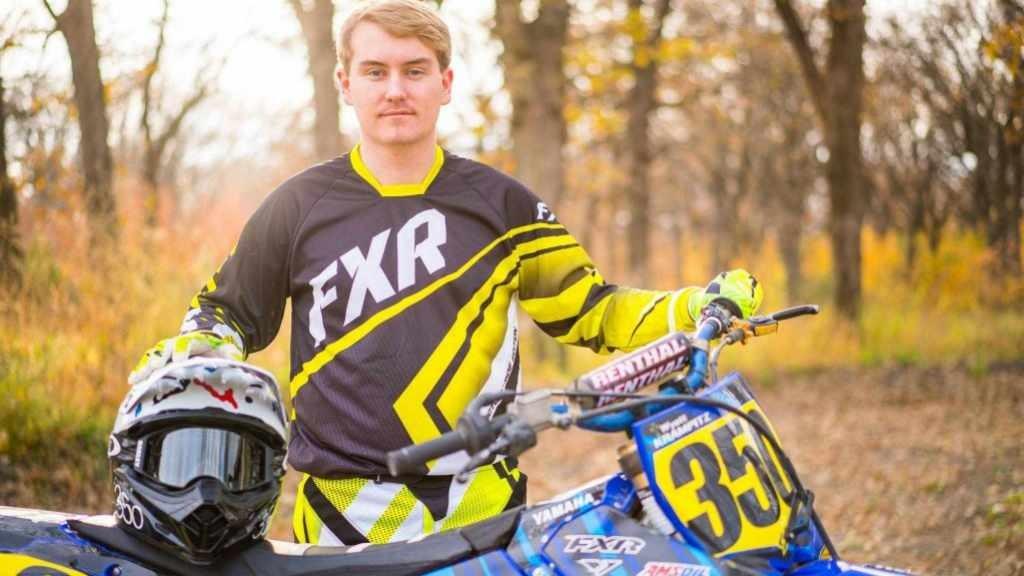Motocross rider Wyatt Krampitz with his motorcycle.
