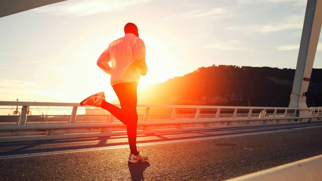 man running, jogging, exercising on bridge
