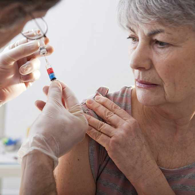 older woman receiving a vaccination