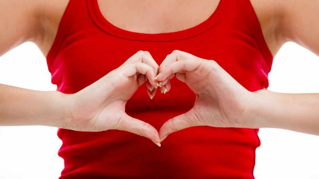 woman making heart health shape with her hands