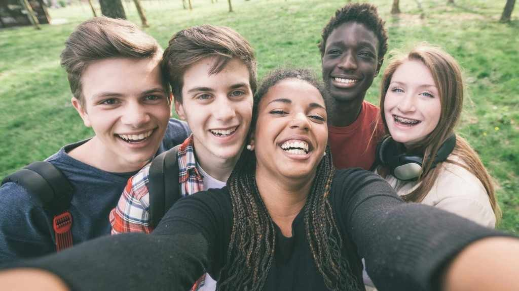 young people taking a selfie picture, laughing and smiling