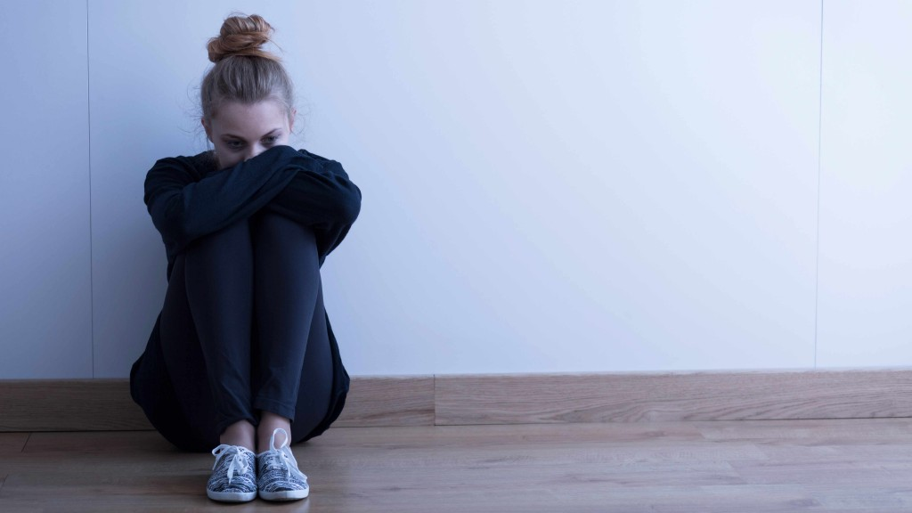 a teenage girl alone and looking sad, depressed
