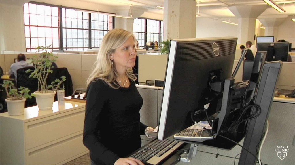 a woman working at a standing desk