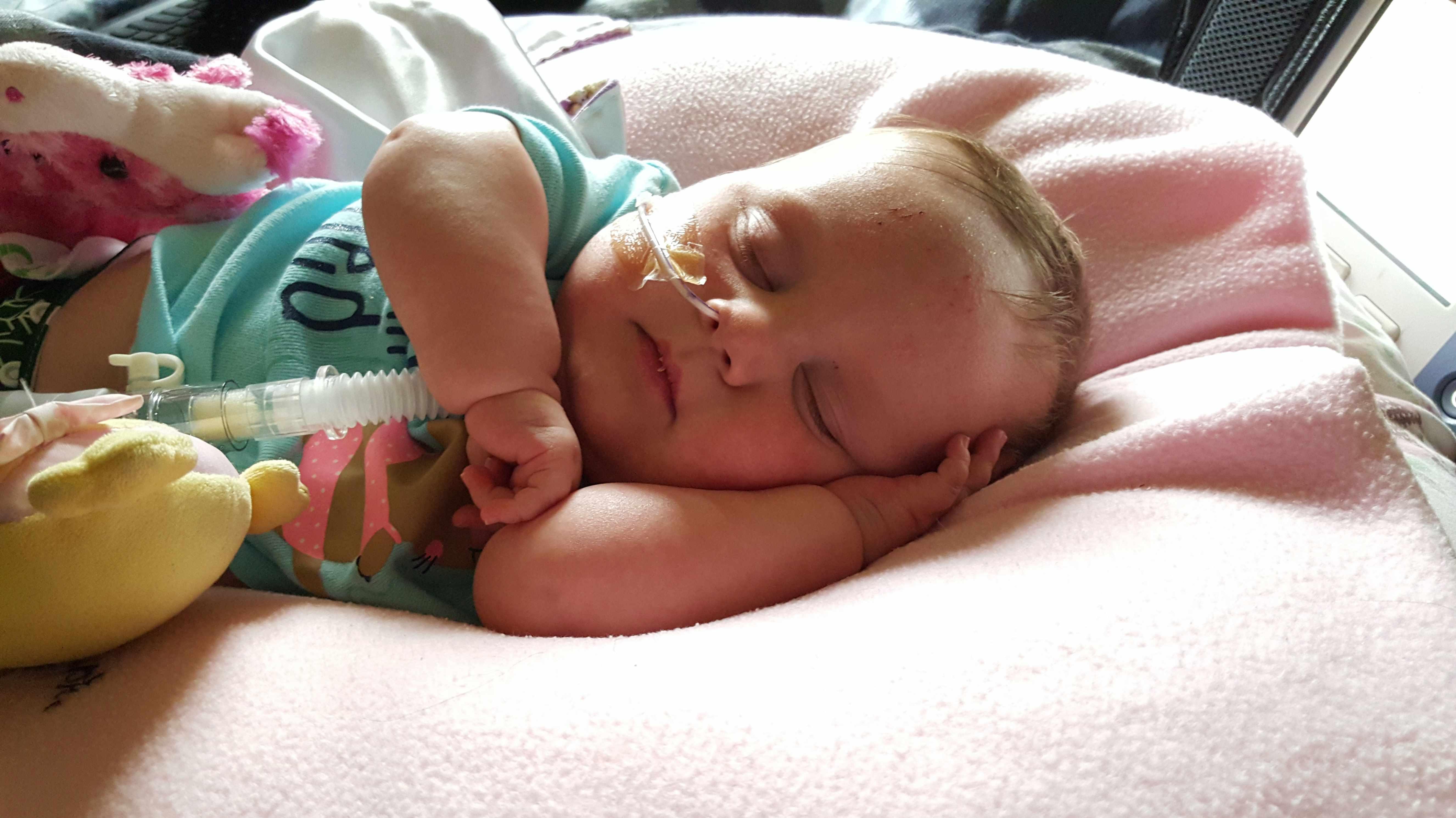 baby Kieran napping peacefully at home