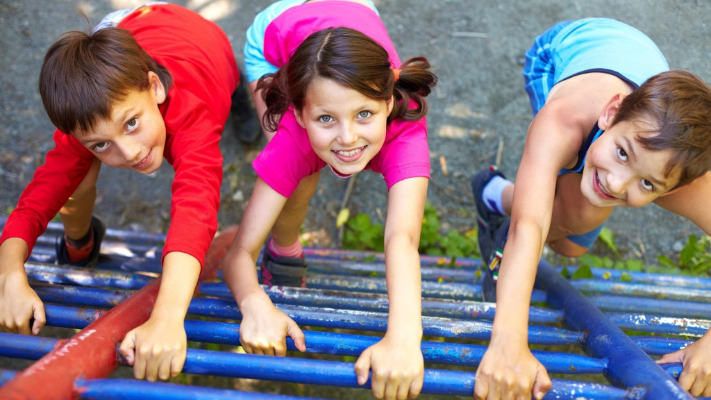children smiling, climbing on the playground