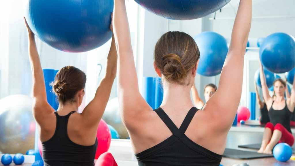 women using exercise balls in Pilates class