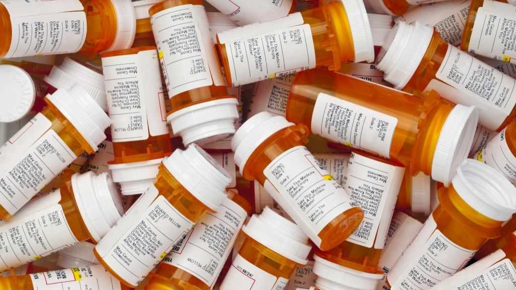 pile of prescription drug bottles 16x9
