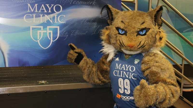 Minnesota Lynx mascot in front of Mayo Clinic sign