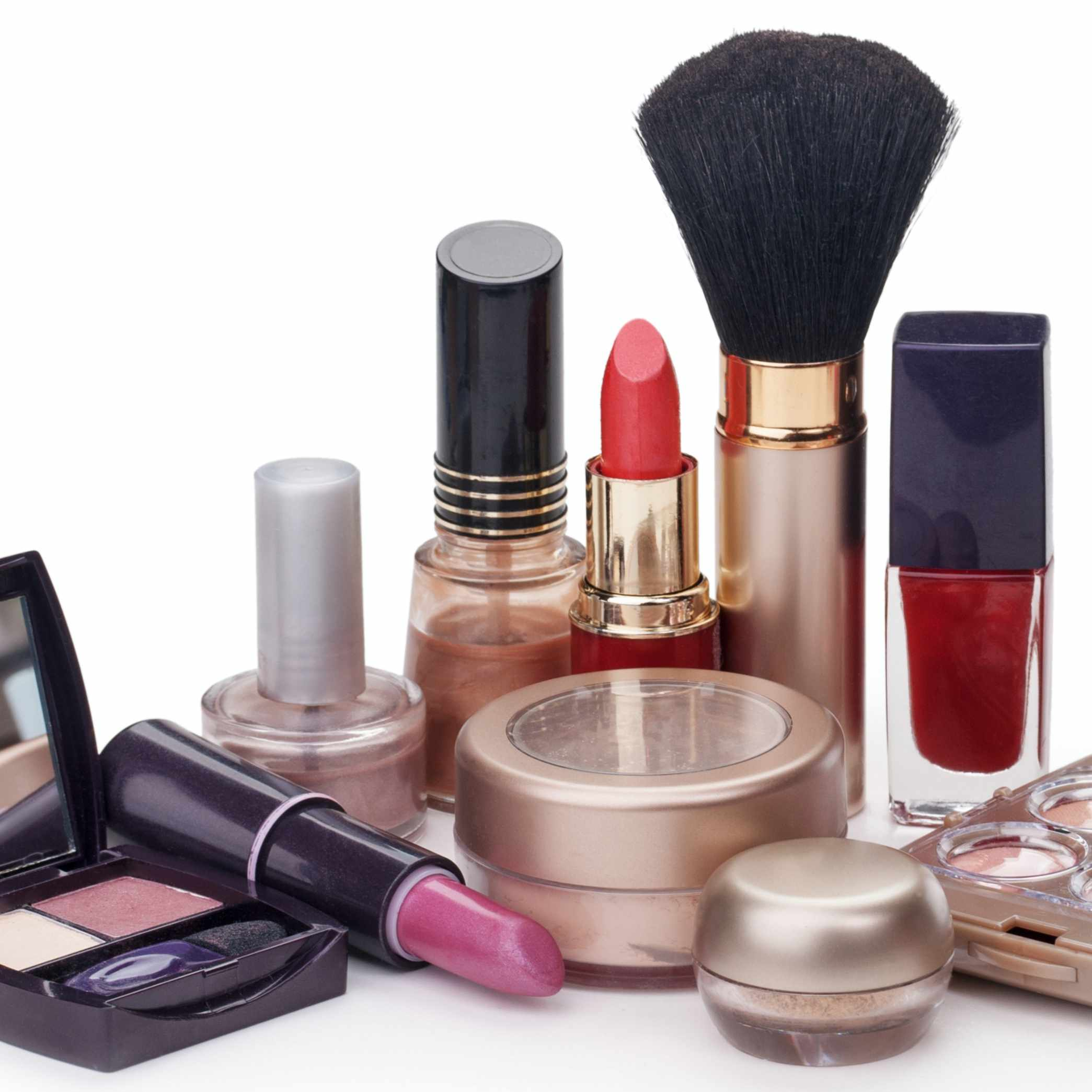 a collection of make up arranged on a table, including lipstick and eyeshadow
