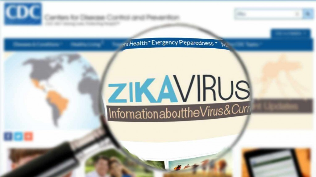 "a computer monitor screen of the CDC website with a magnifying glass, illustrating the words ""Zika virus"""