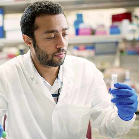 a male researcher working in a laboratory