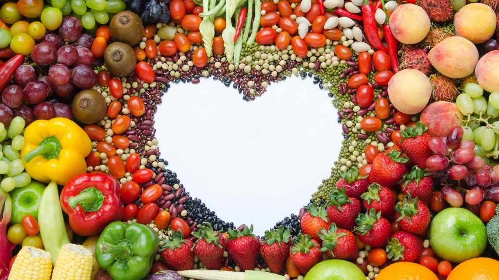 assorted fruits and vegetables formed into a heart