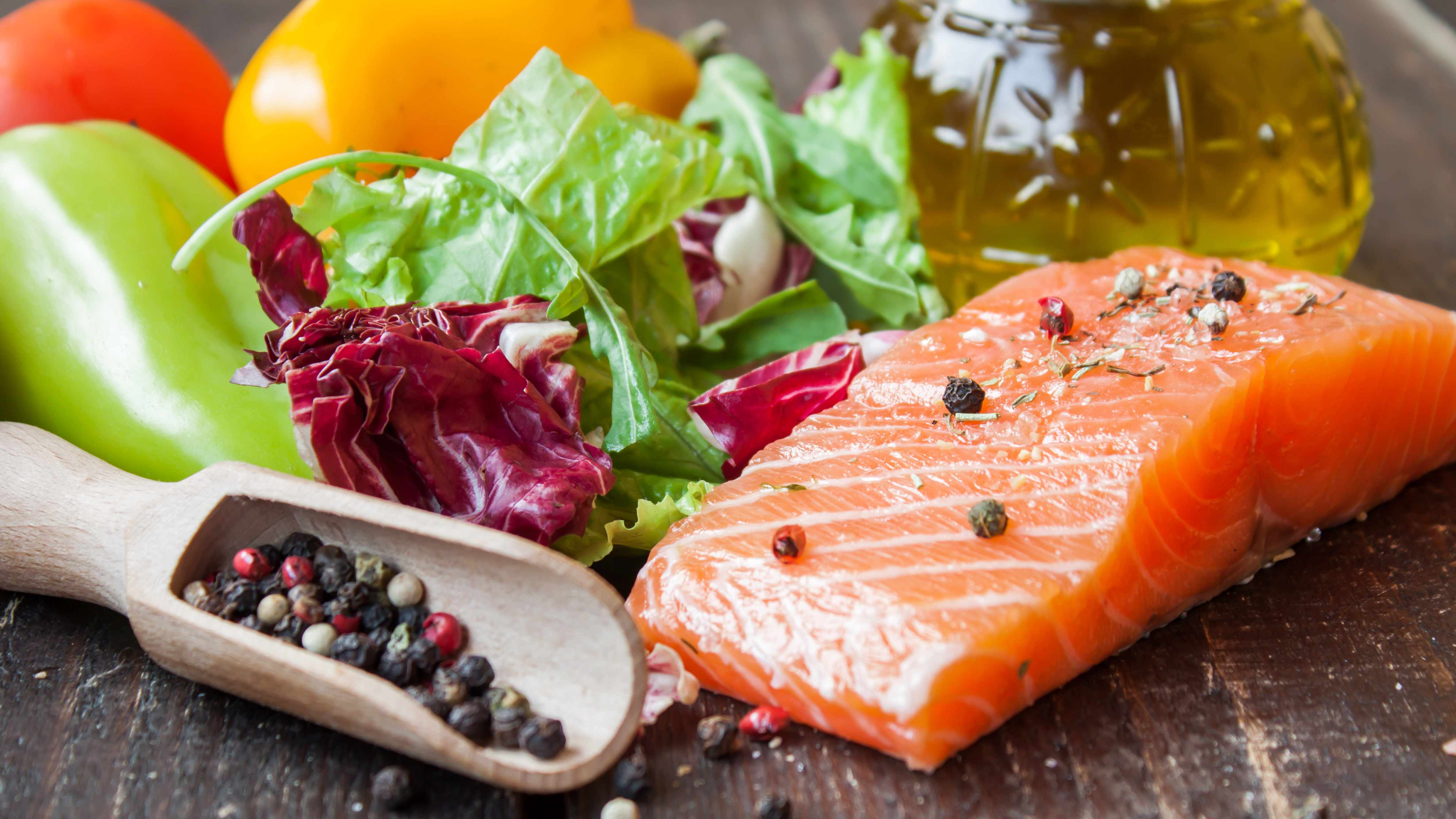 a sample mediterranean diet with fish, nuts, fruits and vegetables