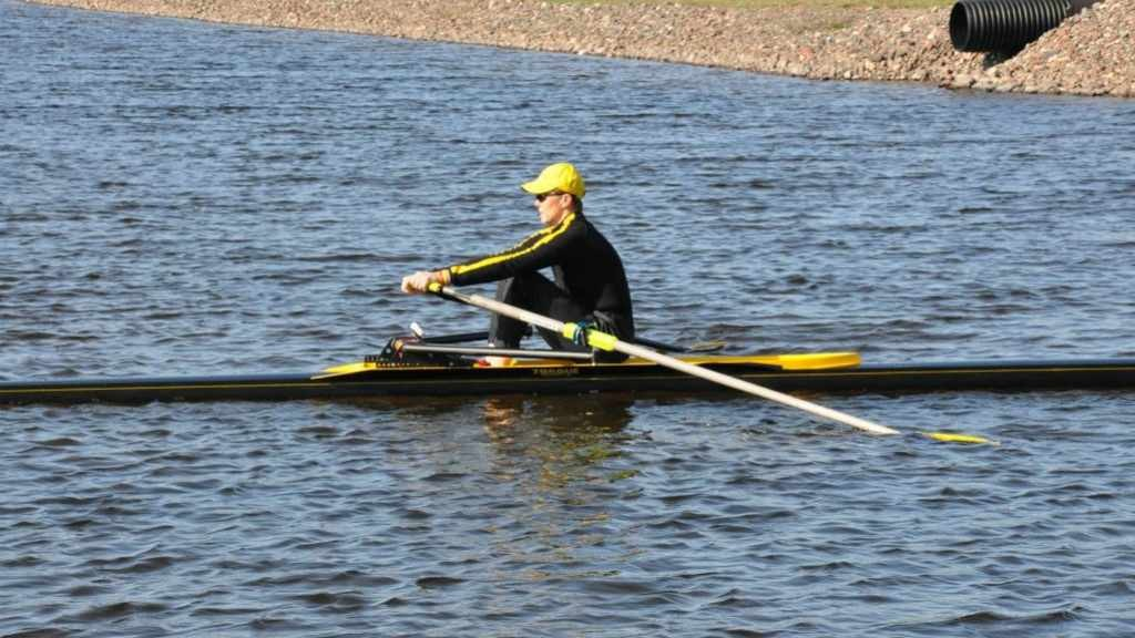 patient Terry Smythe in a rowing shell on the water