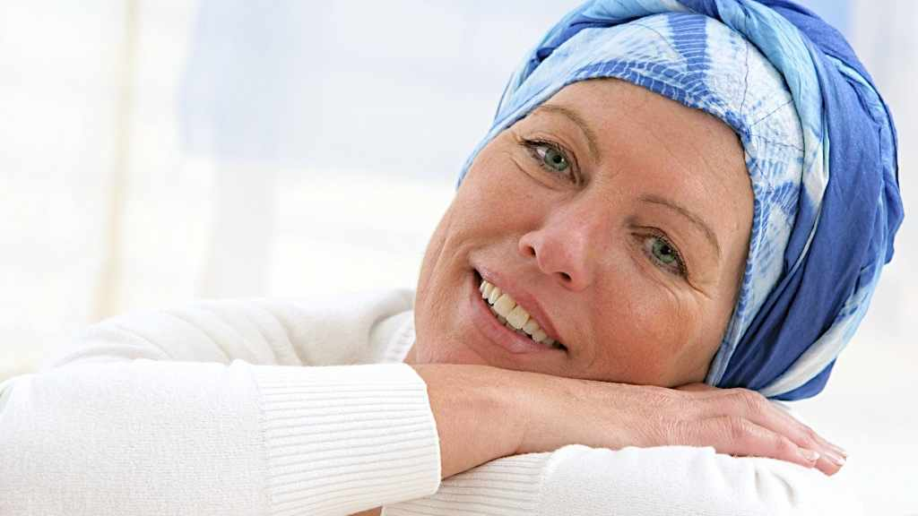 woman with headscarf on after chemotherapy