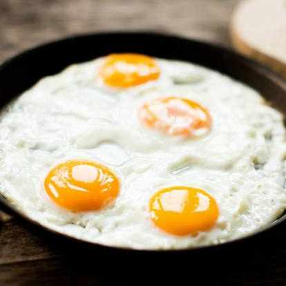 eggs cooking in a frying pan
