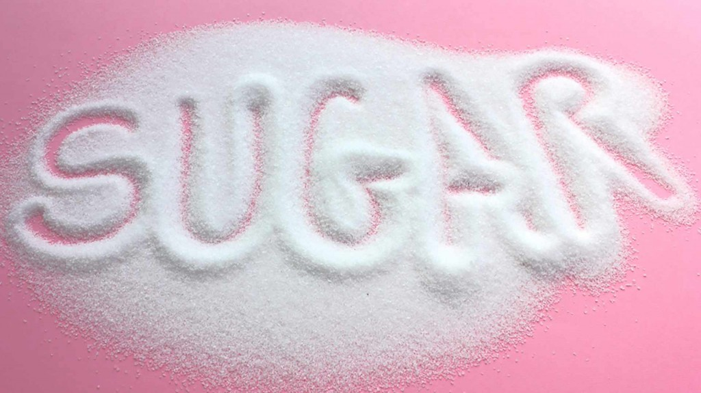the word sugar written in spilled sugar