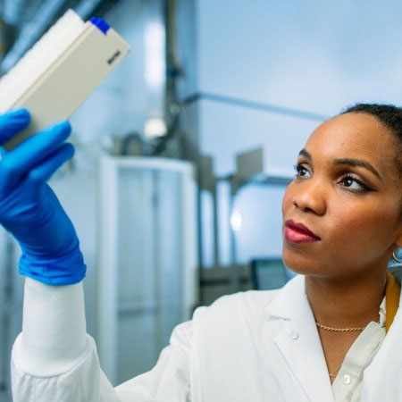 Mayo Clinic Biobank- Biospecimen Processing Technician, Mimi Iyorbo, inspects a rack of samples ready for storage in the Mayo Clinic robotic freezer.