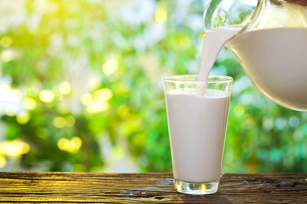milk being poured into a glass