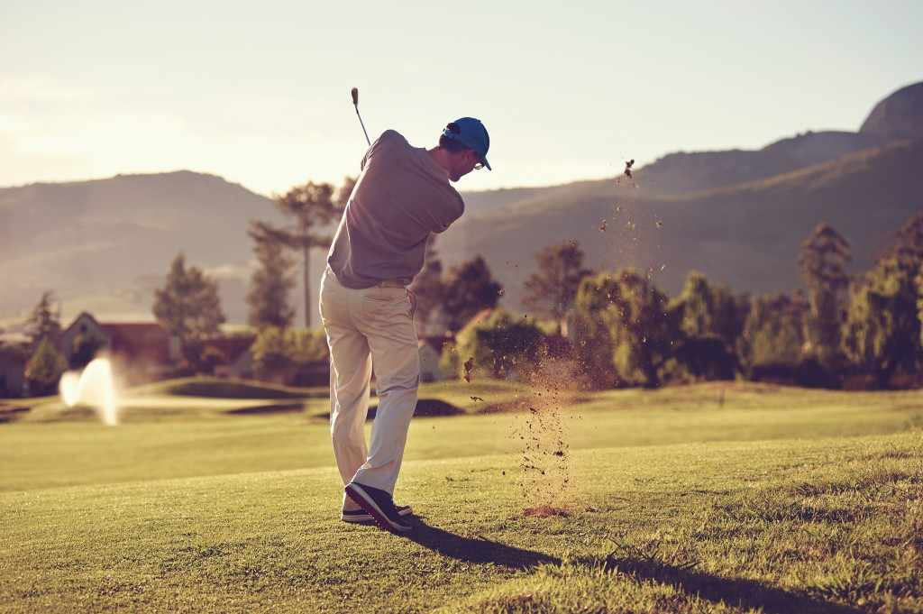 a golfer taking a full golf swing