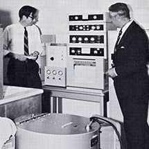 Drs. A.F. Hofman and W.H.J. Summerskill examining a new liquid gass chromatograph in the GI Unit biochemistry laboratory