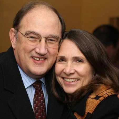 patient Dr. James Biles hugging his wife and smiling