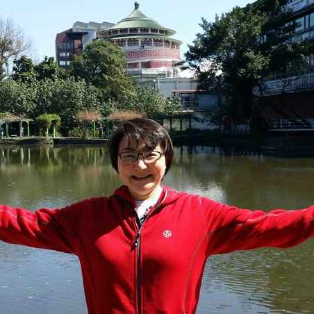 patient Vivian Tsai standing outside near a lake