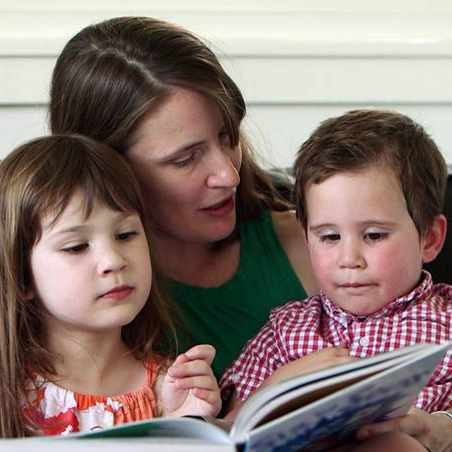 stroke patient Sherry Pinkstaff reading a book with her two children