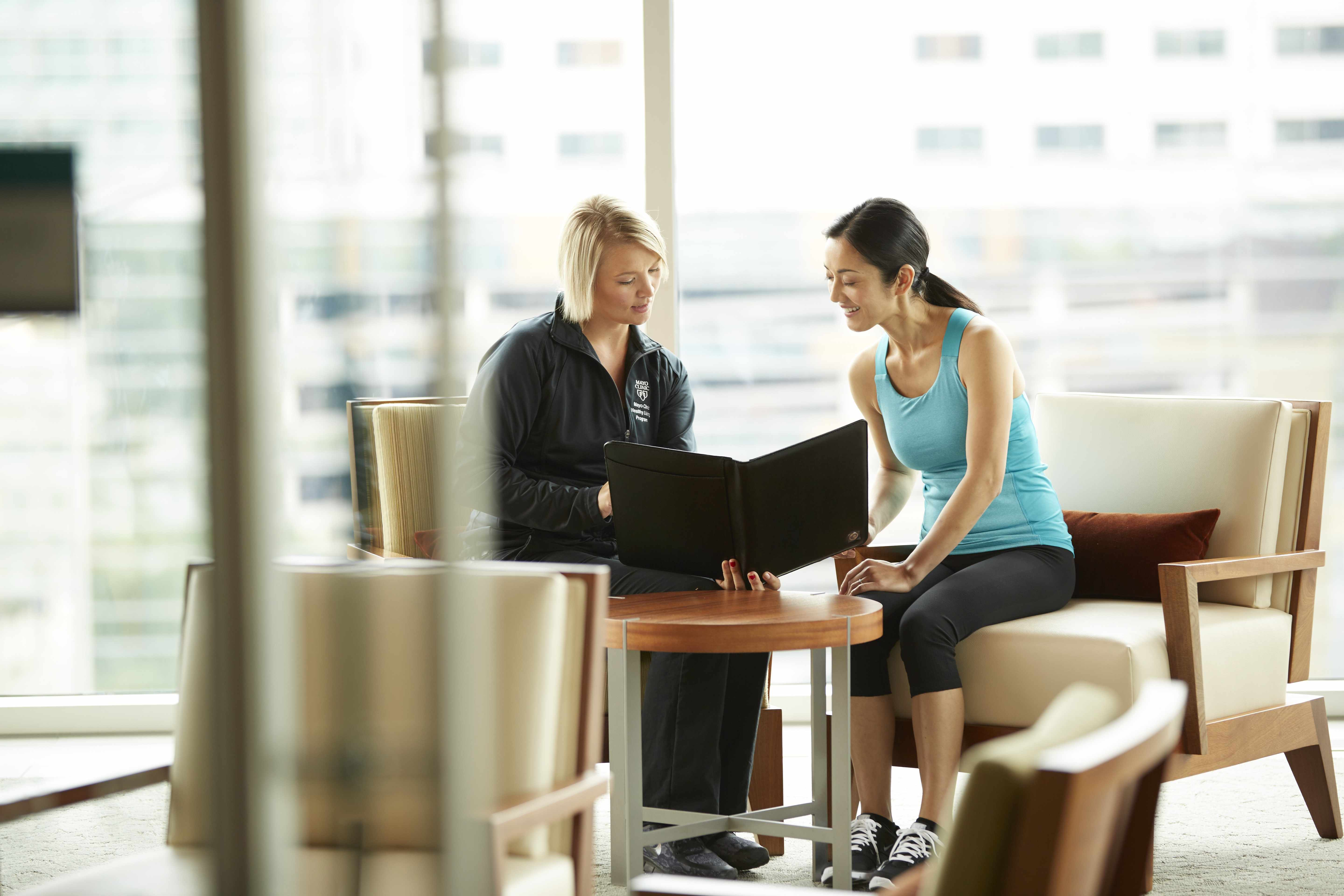 wellness coach and patient consulting with each other