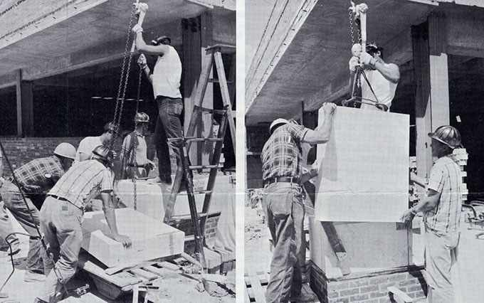 workers placing a corner stone on the 19th floor of the Mayo Building