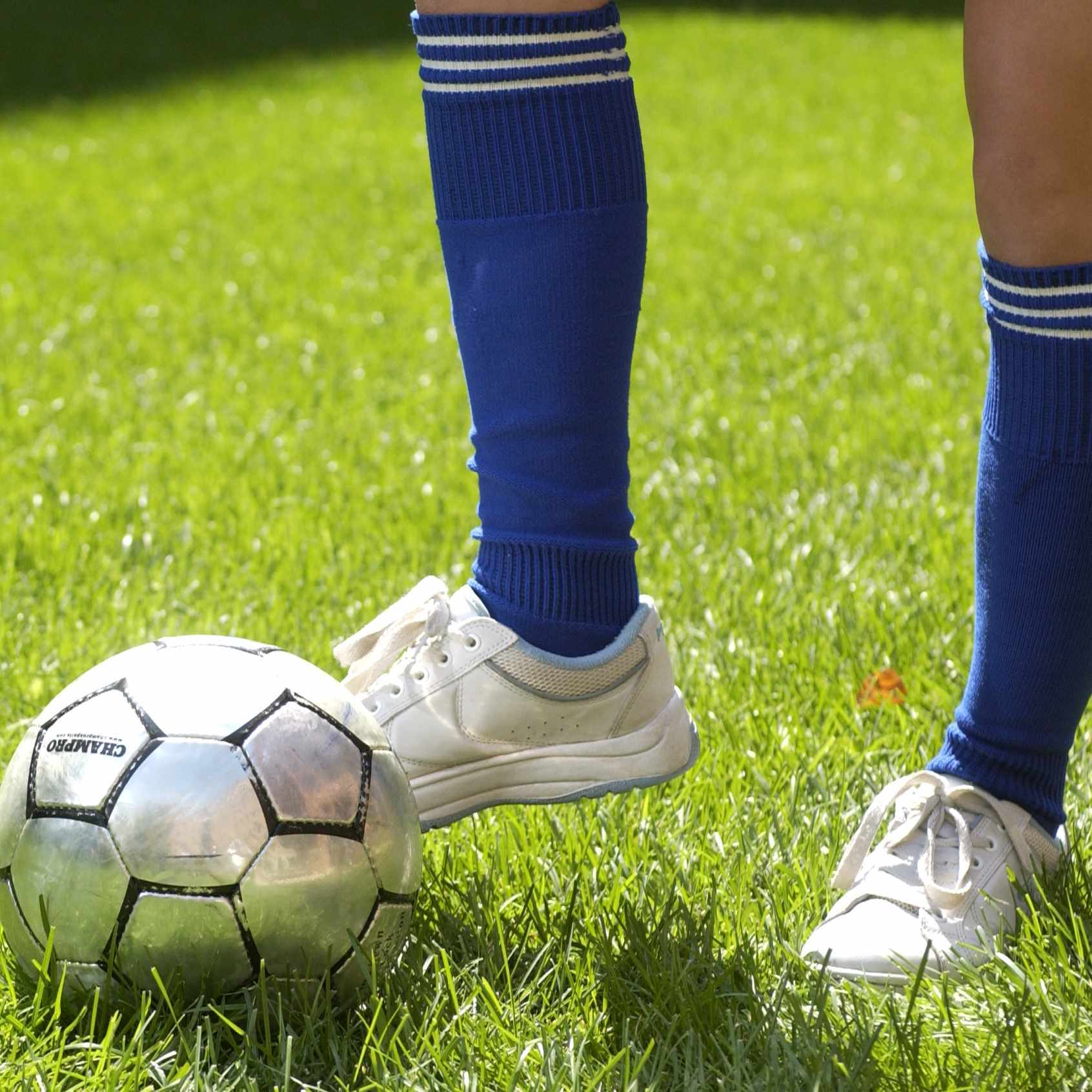 Foot and leg next to soccer ball