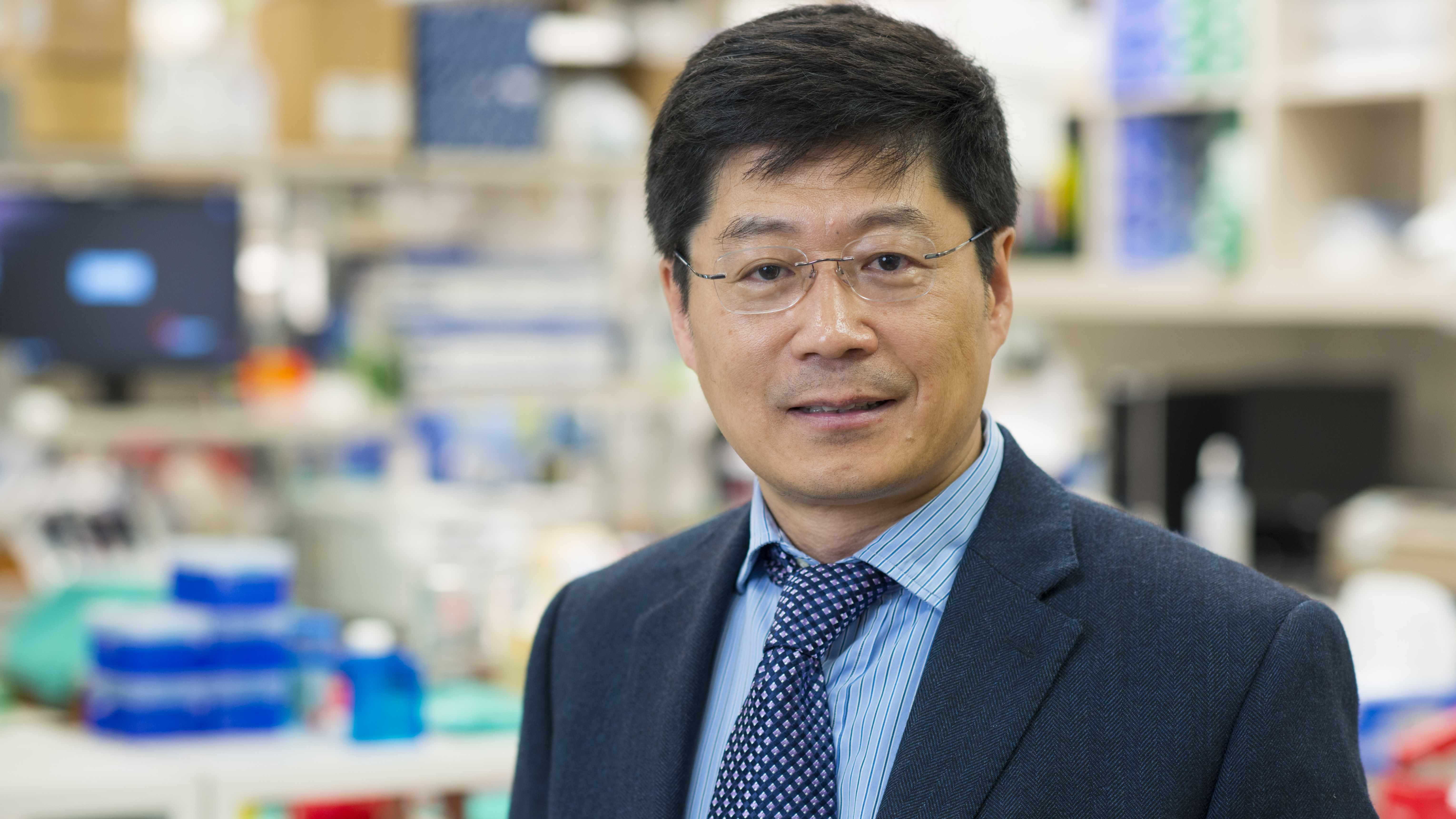 Dr. Guojun Bu