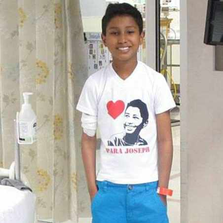 pediatric patient Joseph Gonzalez-Salas standing in his hospital room