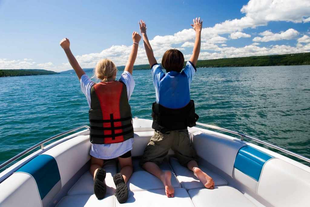 two young people in a boat wearing life jackets