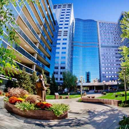 artistic lens photo of Gonda Building with blue skies, Damen parking ramp and Founder's Park