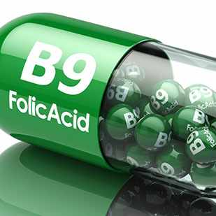 a green pill capsule that reads B9 Folic Acid
