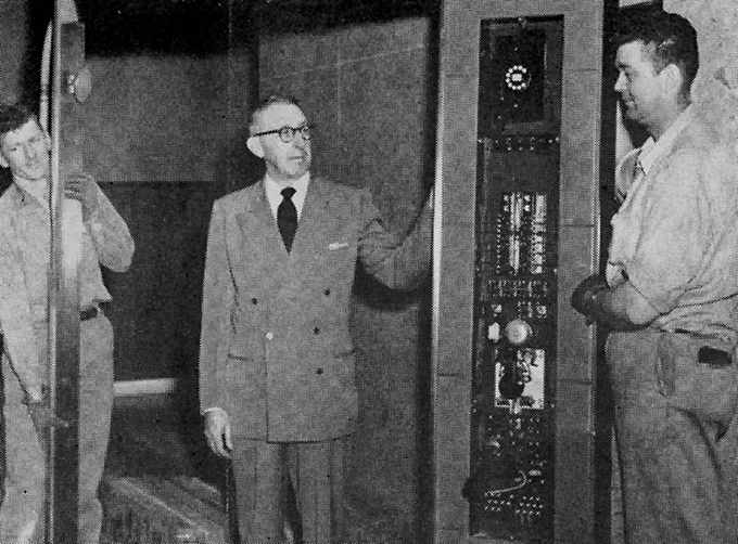 a 1956 photograph of General Service's Clyde Crume and Westinghouse elevator men Elton Butlin and Floyd Dawley, at work in a new patient elevator