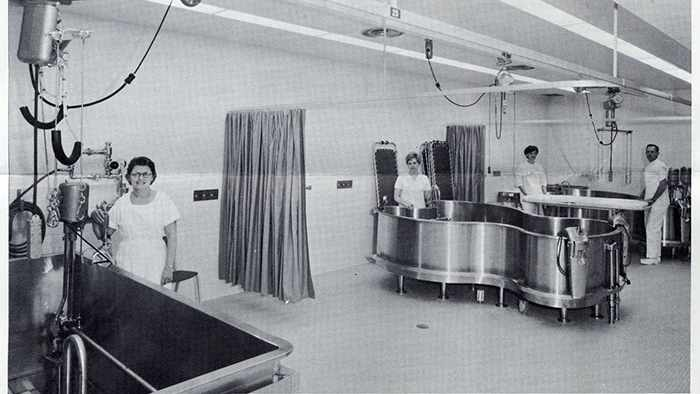 a 1967 photo of Lucy Sivly and Janet Borg, PT aides; Lorraine Jensen and Edwin Wessner, staff therapists; and walk-in tank and two Hubbard tanks for hydrotherapy
