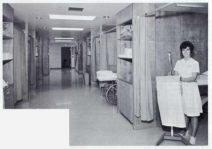 a 1967 photo of Physical Therapy senior student Genevieve McElroy in the treatment area