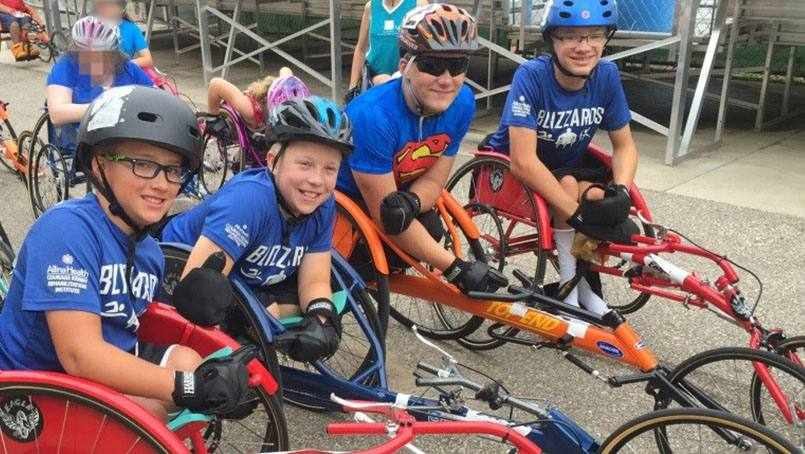 spina bifida patient Ty Wiberg and his team riding bicycles
