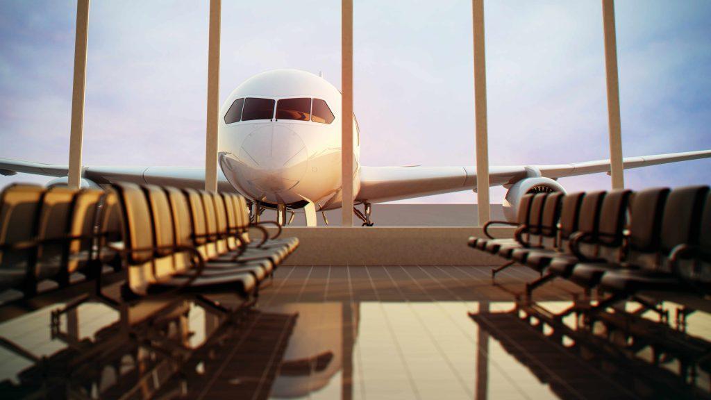 Un avión visto desde la ventana de la sala de espera del aeropuerto