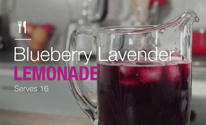 blueberry lavender lemonade in a glass pitcher