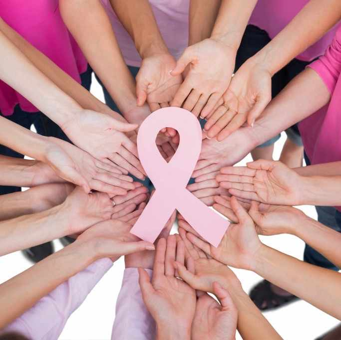 hands holding a breast cancer awareness ribbon
