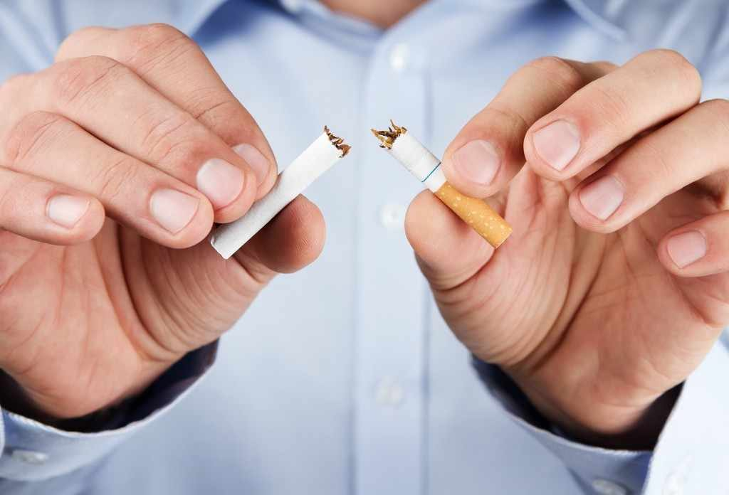 quit smoking, human hands breaking tobacco cigarette
