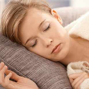 young woman sleeping, napping, resting on couch