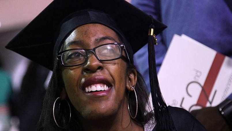 Sharing Mayo Clinic patient Brentney Simon wearing graduation cap