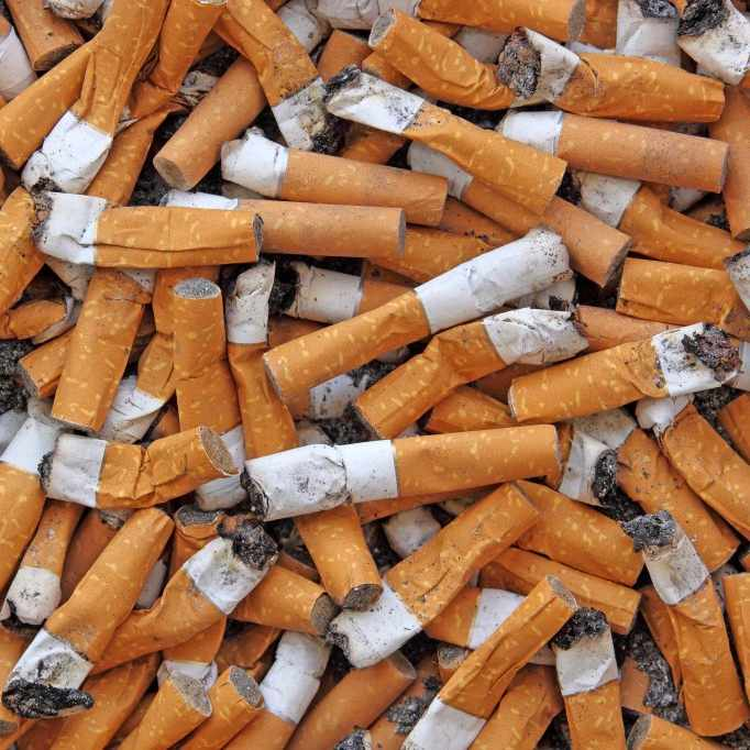 a close-up of a pile for stubbed out cigarettes